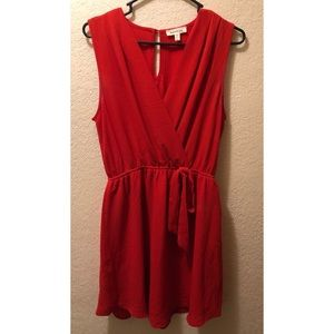 Red Sleeveless Dress with Cinched Waist and Bow